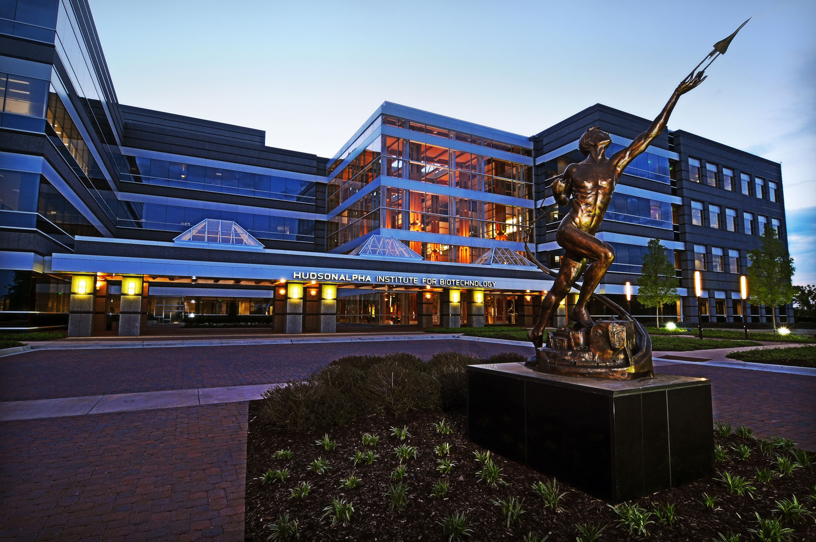 The bronze Power of Thought statue in front of HudsonAlpha
