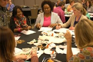 Teachers using the Chromosocks at this year's Huntsville GREAT Workshop.